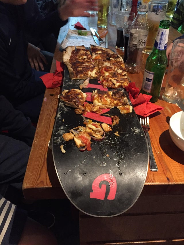 We Want Plates - pizza on snowboard