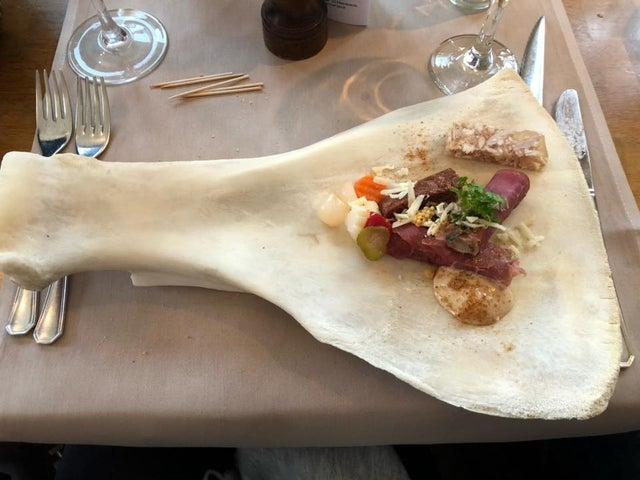 We Want Plates - food on femur bone