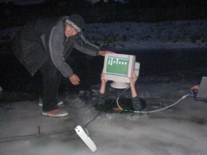 cursed computer image, cursed computer near water image, person holding computer over head in water, person holding computer over head in ice water, person in ice water holding computer over head, person with computer in ice water, person with computer in water, funny cursed image, funny cursed picture, cursed image, cursed picture