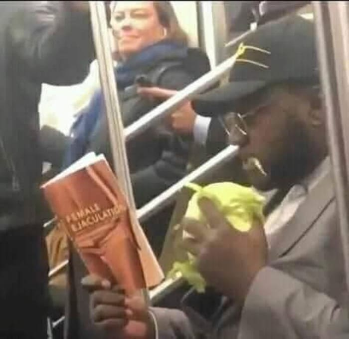 man reading book about female ejaculation, man reading female ejaculation book, man reading female ejaculation book while eating, man eating while reading female ejaculation book, funny image, funny picture, funny cursed image, funny cursed picture