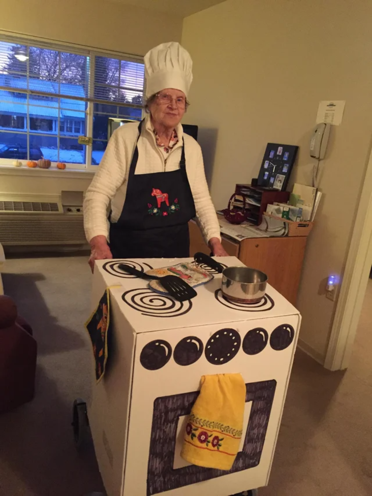 Grandma uses walker in costume as a chef.