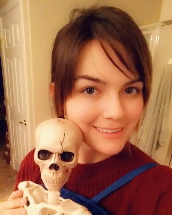 Woman holding skeleton