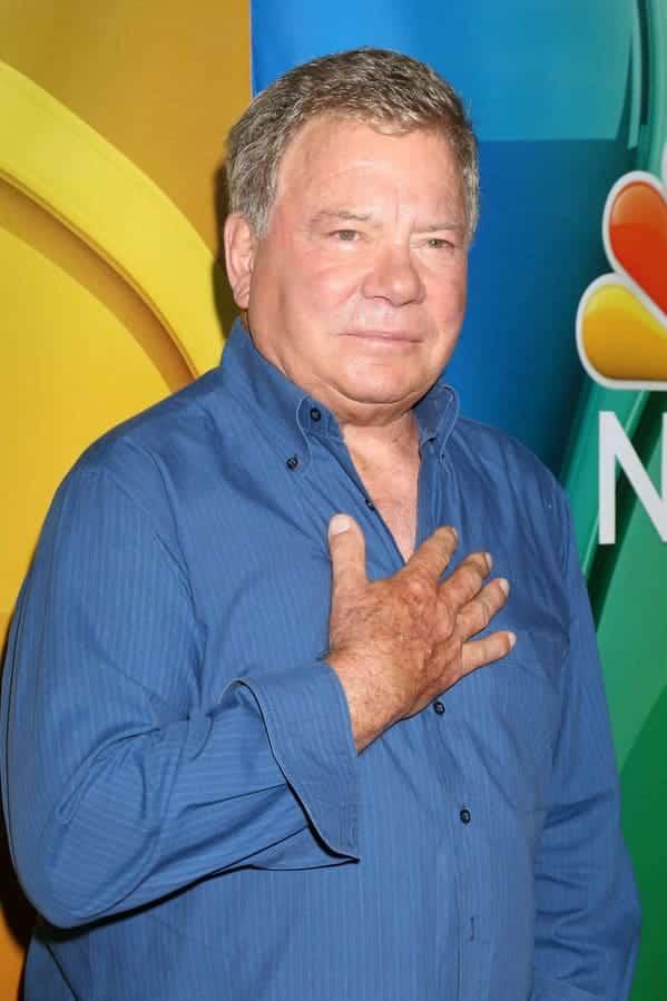 william shatner holding his hand over his heart, Worst songs to listen to during sex, worst sex songs playlist, Spotify funny playlist, worst sex songs, funny songs to make love to, songs that are not sexy, pleated jeans Spotify